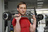 Men lifting weights — Stockfoto