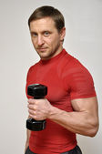 Handsome men with dumbells — Stock Photo