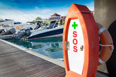 SOS first aid kit, on Marina Harbor — Stock Photo