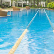 Swimming path in beautiful crystal cline swimming pool — Stock Photo #10379335