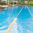 Swimming path in beautiful crystal cline swimming pool — Stock Photo