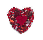 Shape of heart made with mix of confetti and crystals, isolated — Stock Photo