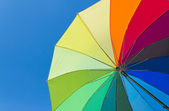 Colorful umbrella on a sky background — Foto de Stock