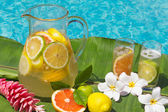 Lemonade by swimming pool side — Stock Photo