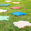 Colorful Stone block walk path in the park with green grass back — Stock Photo