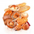 Rolls, muffins, pastries, lots of rolls, baguettes, bagels, buns, puffs — Stock Photo