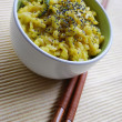 Yellow rice and chopsticks — Stockfoto