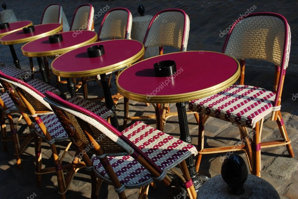 Typical outdoor cafe with tables and chairs on the sidewalk in Paris, France — Stock Photo #9298415