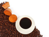 Cup of coffee, muffin and beans — Stock Photo