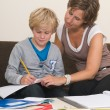 Doing homework with mother — Stock Photo #9293942