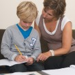Doing homework with mother — Stock Photo