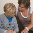 Стоковое фото: Doing homework with mother