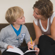Doing homework with mother — Stockfoto #9294003