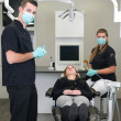 Dentist with nurse and patient — Stock Photo #9742905