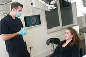 Dentist and his patient — Stock Photo