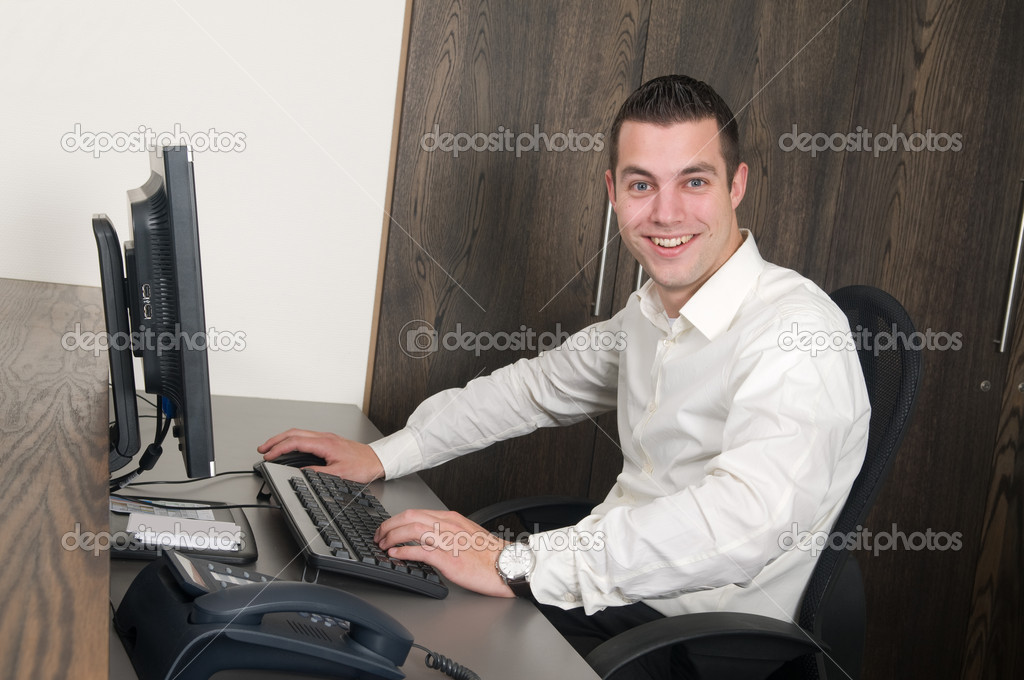 Male working at a computer in an office — Stock Photo #9742828