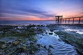 Beautiful colorful sunrise along the coast — Stock Photo