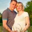 Pregnant couple in the park — Stock Photo #8881973