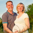 Pregnant couple in the park — Stock Photo #8882003