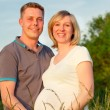 Stock Photo: Pregnant couple in the park