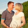 Pregnant couple in the park — Stock Photo #8882050