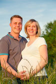 Pregnant couple in the park — Stock Photo