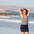 Young woman on a beach — Stock Photo #9136339