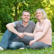 Pregnant couple in the park — Stock Photo #9360786