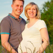 Pregnant couple in the park — Stock Photo #9360840