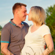 Pregnant couple in the park — Stock Photo #9360856
