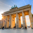 Brandenburg gate at sunset - Stockfoto