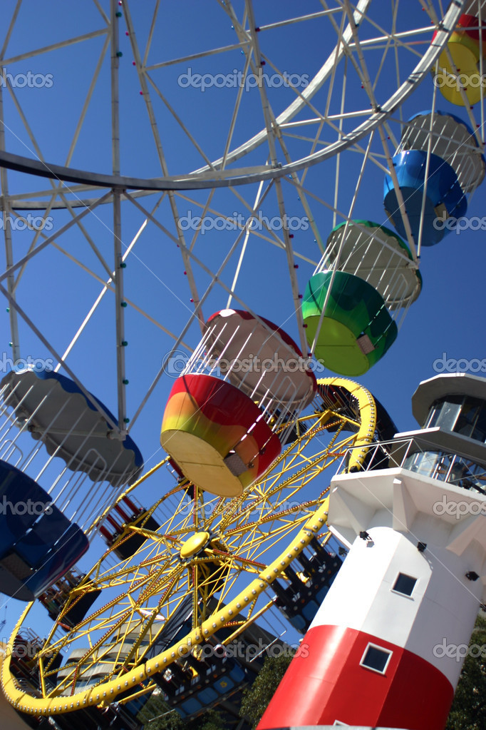 A colorful ferris wheel with blue sky. — Stock Photo #8088929