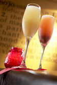 Rossini and bellini cocktail on bar with wall writing — Stock Photo