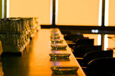 Ashtrays lined up on a bar — Stock Photo