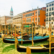 Venezia, Italy - Gondolas on Grand Canal and San Marco bell tower - Stock Photo