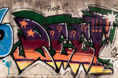 Graffiti on concrete wall — Stok fotoğraf