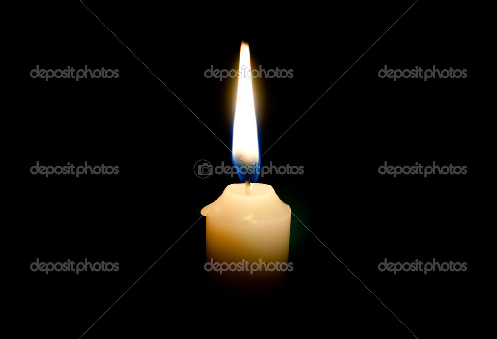 Burning candle on a black background — Stockfoto #10238904