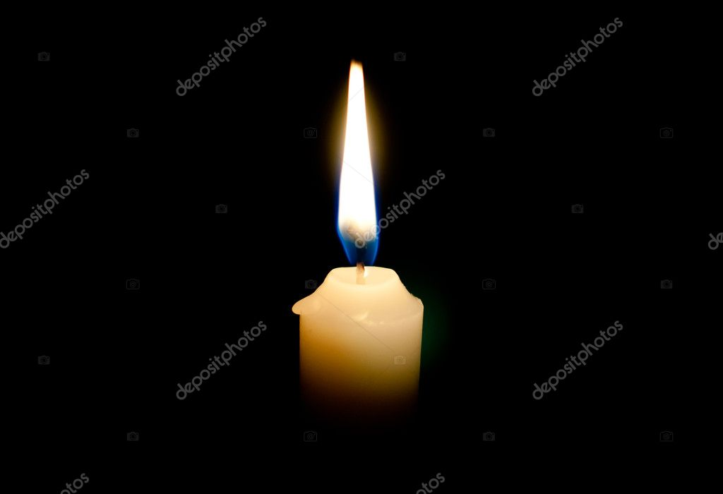 Burning candle on a black background — Photo #10238904