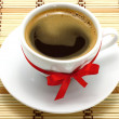Coffee cup with red bow - Stock Photo