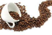White cup and coffee beans path — Stock Photo