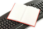 Notepad on a computer keyboard — Stock Photo