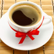Coffee cup with red bow — Stockfoto