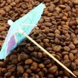 Cocktail umbrella on a coffee beans — Lizenzfreies Foto