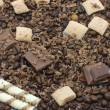 Chocolate pieces and coffee beans — Stockfoto