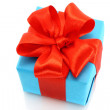 Present box with red bow — Stock Photo