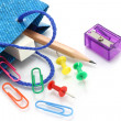 Stationery items poured out from shopping bag - Stock Photo