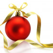 Red Christmas ball with golden ribbon - Stock Photo