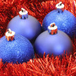 Blue Christmas balls with red tinsel - Stockfoto