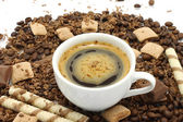 Cup of coffee with chocolates — Stock Photo