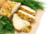 Baked chicken on wooden board — Stock Photo